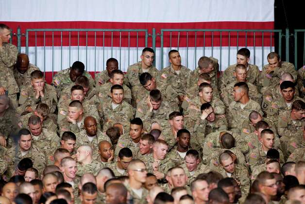 Fort Bliss soldiers wait for President Barack Obama to arrive to address them at Fort Bliss Military Instillation on Friday August 31, 2012. The President met privately with service members and their families and to highlight the second anniversary of the end of combat operations in Iraq. Photo by Ivan Pierre Aguirre Photo: Ivan Pierre Aguirre, San Antonio Express-News / Ivan Pierre Aguirre