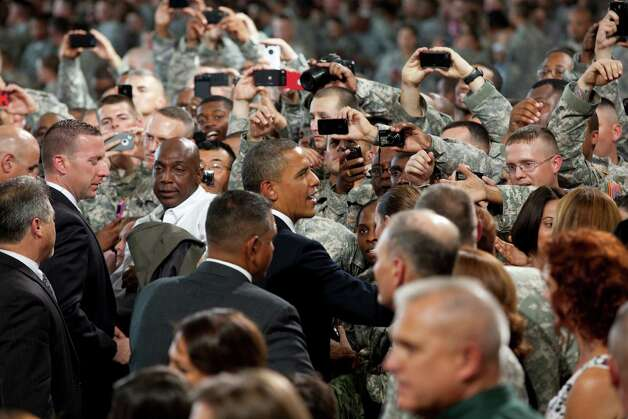 President Barack Obama shakes hands with the troops after addressing them at Fort Bliss Military Instillation on Friday August 31, 2012. The President met privately with service members and their families and to highlight the second anniversary of the end of combat operations in Iraq. Photo by Ivan Pierre Aguirre Photo: Ivan Pierre Aguirre, San Antonio Express-News / Ivan Pierre Aguirre