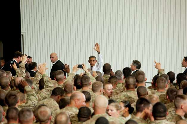 President Barack Obama waves goodbye to troops after addressing them at Fort Bliss Military Instillation on Friday August 31, 2012. The President met privately with service members and their families and to highlight the second anniversary of the end of combat operations in Iraq. Photo by Ivan Pierre Aguirre Photo: Ivan Pierre Aguirre, San Antonio Express-News / Ivan Pierre Aguirre