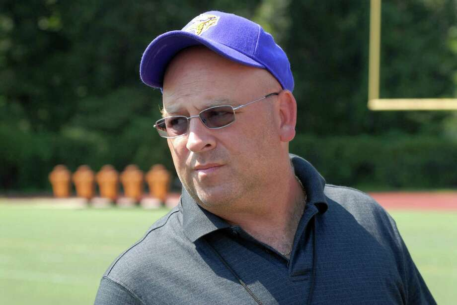Westhill High School football coach Frank Marcucio talks in Stamford, Conn. on Friday August 31, 2012 about the loss of former Westhill quarterback  Peter Cernansky who died Thursday, two days after being critically injured in a skateboarding accident in Burlington, Vt. Photo: Dru Nadler / Stamford Advocate Freelance