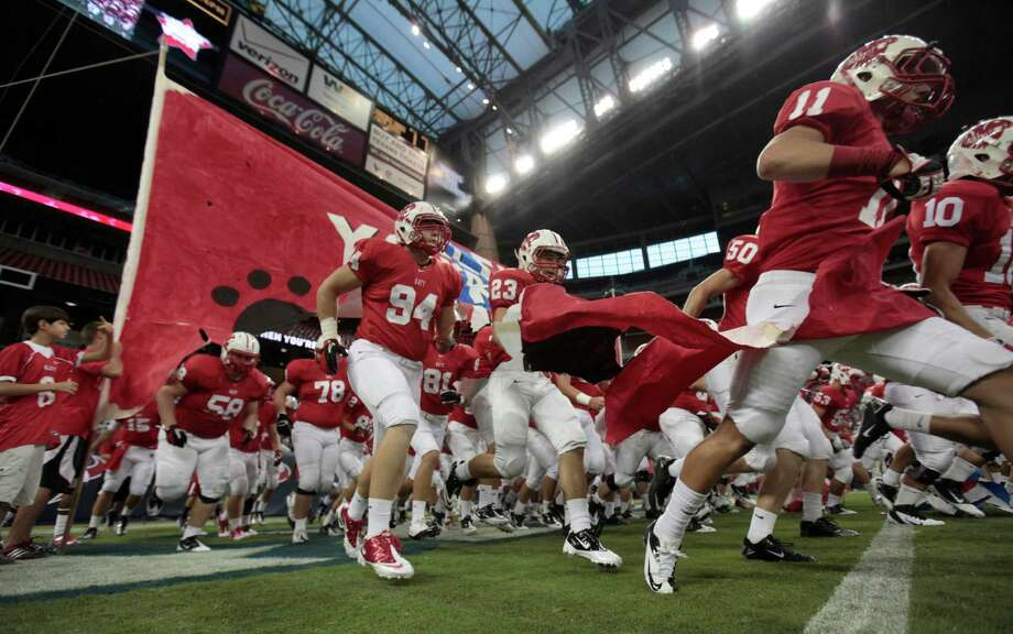 Thew Katy Tigers take the field to face the Klein Bearkats, Friday, August 31, 2012 at Reliant Stadium in Houston. Photo: Eric Christian Smith, For The Chronicle