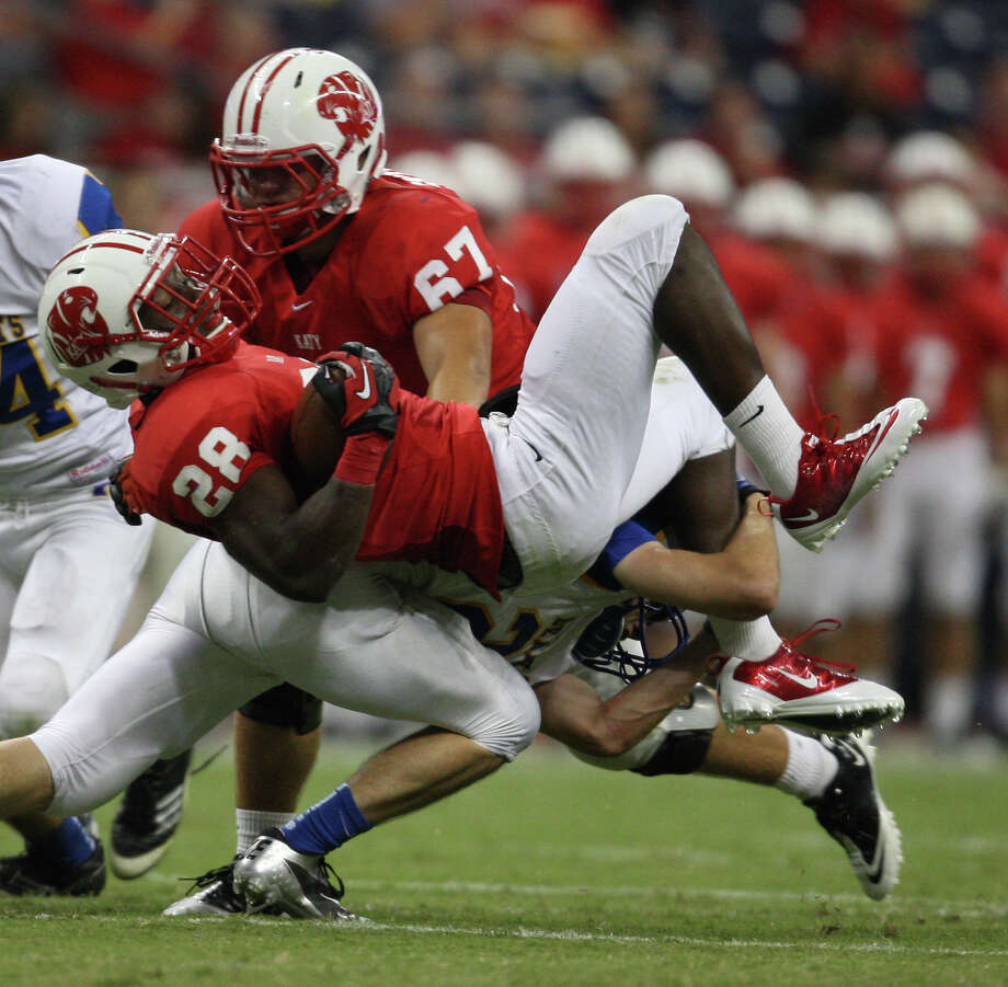 Katy's Rodney Anderson is tackled by Klein's B.J. Fashola during the first half of a high school football game, Friday, August 31, 2012 at Reliant Stadium in Houston. Photo: Eric Christian Smith, For The Chronicle