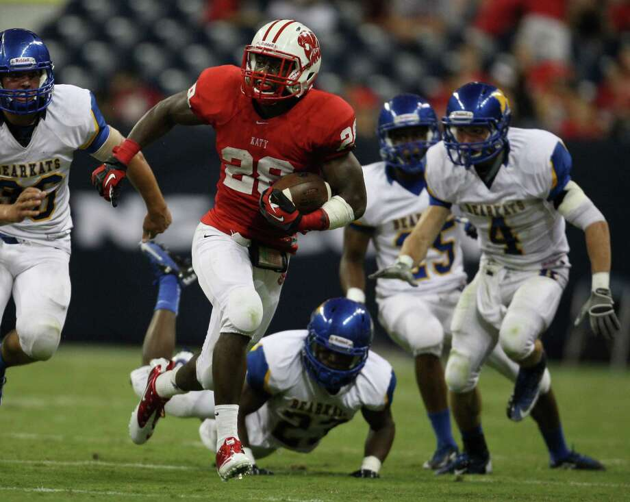 Katy's Adam Taylor (28) looks for running room against the Klein defense during the first half of a high school football game, Friday, August 31, 2012 at Reliant Stadium in Houston. Photo: Eric Christian Smith, For The Chronicle
