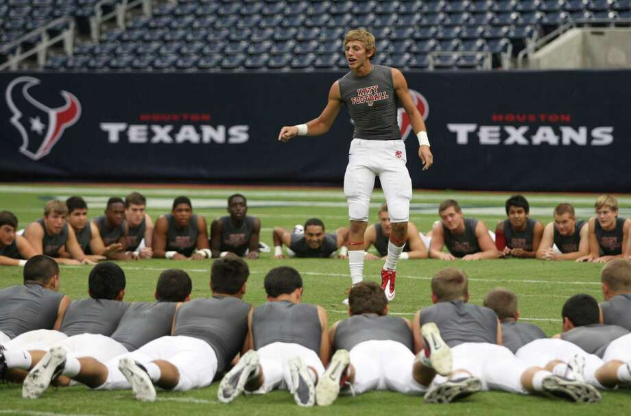 Katy High School linebacker Carson Strickler motivates his teammates during warmups before their game against the Klein Bearkats, Friday, August 31, 2012 at Reliant Stadium in Houston. Photo: Eric Christian Smith, For The Chronicle