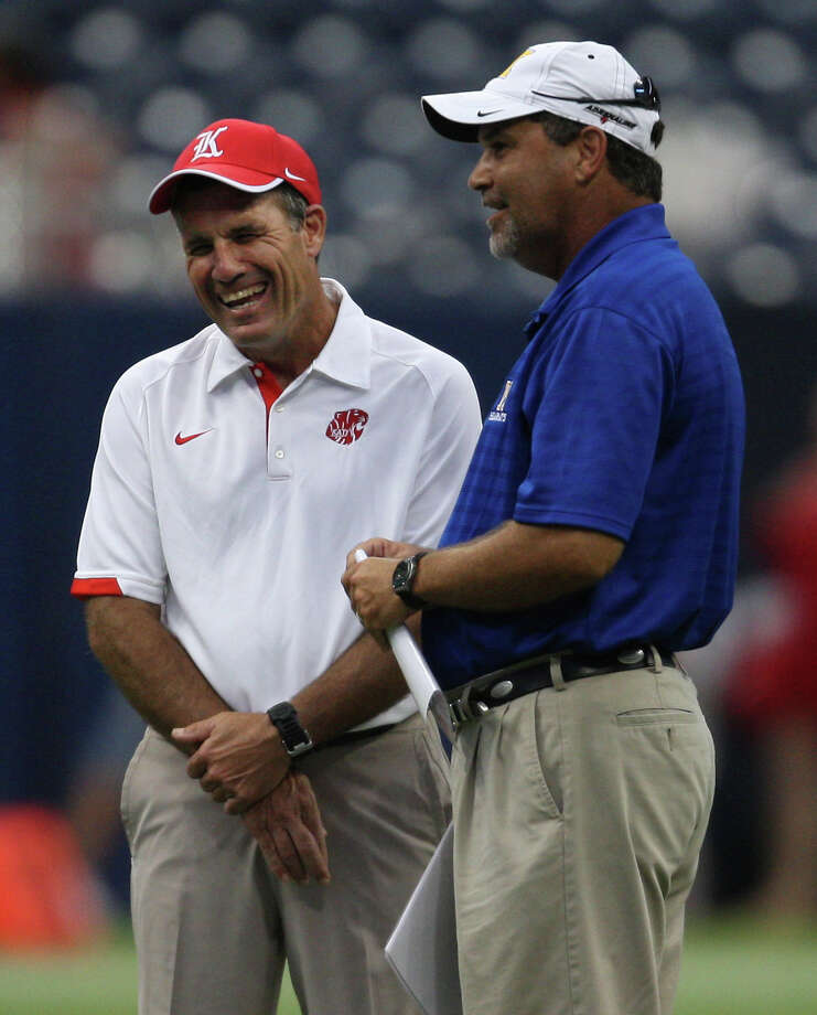 Katy head coach Gary Joseph (left) shares a laugh with Klein head coach Shane Hallmark during warmups before their game, Friday, August 31, 2012 at Reliant Stadium in Houston. Photo: Eric Christian Smith, For The Chronicle