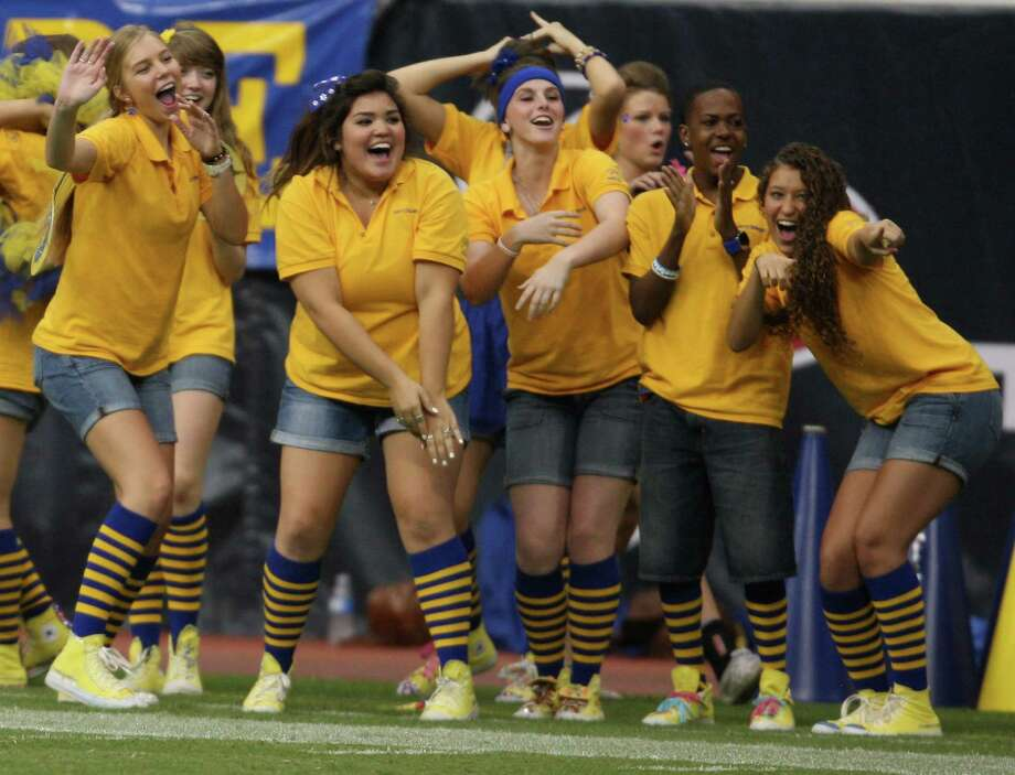 Klein Standleaders cheer on as the Klein Bearkats take the field for warmups before their game against the Katy Tigers, Friday, August 31, 2012 at Reliant Stadium in Houston. Photo: Eric Christian Smith, For The Chronicle