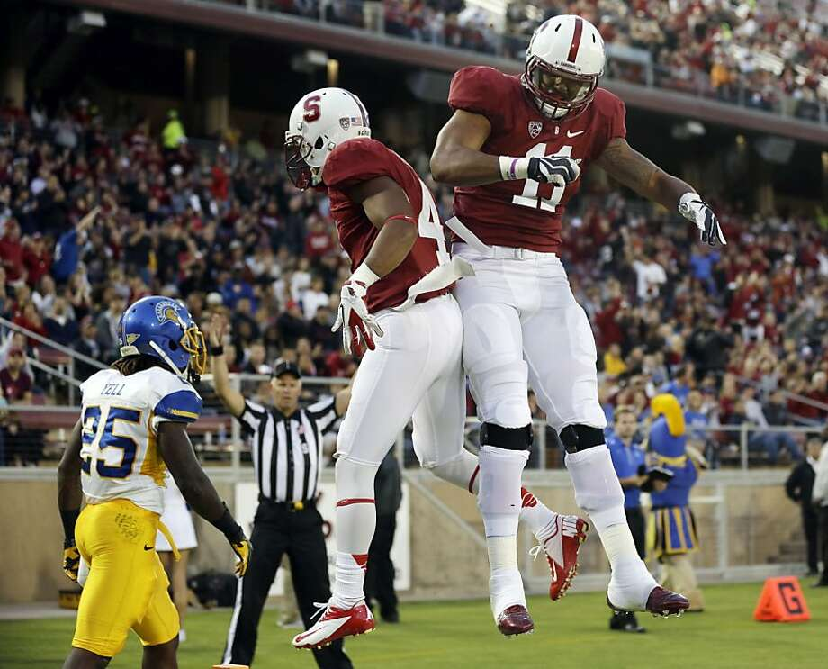Stanford wide receiver Drew Terrell, center, celebrares his 11-yard touchdown catch with teammate Levine Toilolo (11) during the first half of an NCAA college football game in Stanford, Calif., Friday, Aug.  31, 2012. (AP Photo/Marcio Jose Sanchez) Photo: Marcio Jose Sanchez, Associated Press