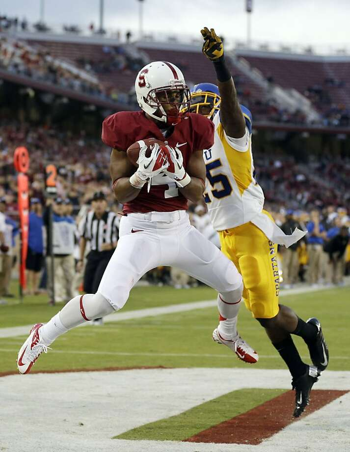 Stanford wide receiver Drew Terrell (4) grabs an 11-yard touchdown next to San Jose State cornerback Ronnie Yell (25) during the first half of an NCAA college football game in Stanford, Calif., Friday, Aug.  31, 2012. (AP Photo/Marcio Jose Sanchez) Photo: Marcio Jose Sanchez, Associated Press