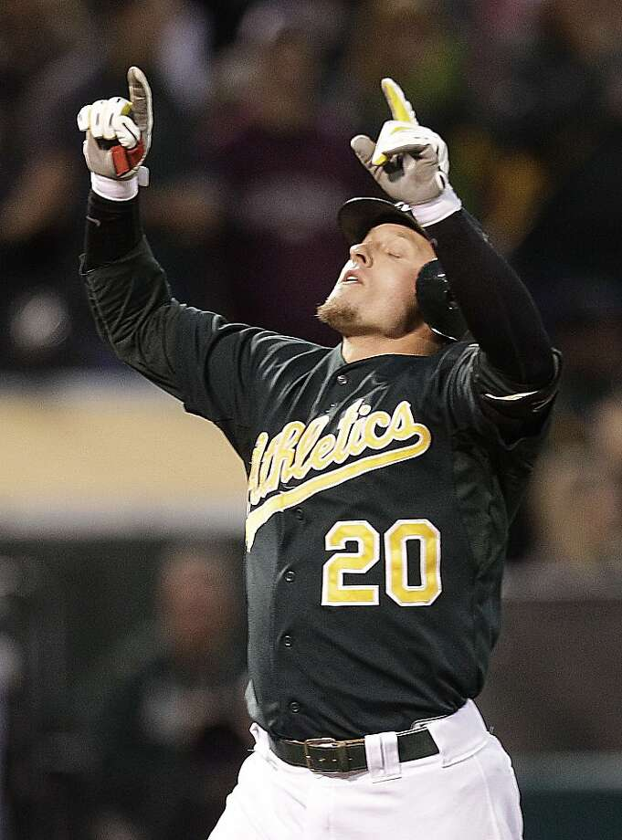 Oakland Athletics' Josh Donaldson celebrates after hitting a two-run home run off Boston Red Sox's Aaron Cook in the second inning of a baseball game Friday, Aug. 31, 2012, in Oakland, Calif. (AP Photo/Ben Margot) Photo: Ben Margot, Associated Press