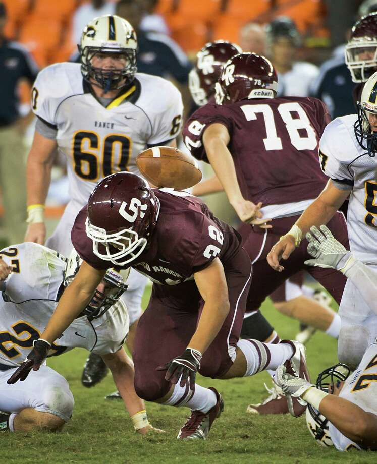 Cinco Ranch running back Blake Hirsch (32) has his fumble land on his back before bouncing into the hands of a Cy Ranch defender during the fourth quarter of a high school football game at BBVA Compass Stadium, Friday, Aug. 31, 2012, in Houston. Photo: Smiley N. Pool, Houston Chronicle / © 2012  Houston Chronicle