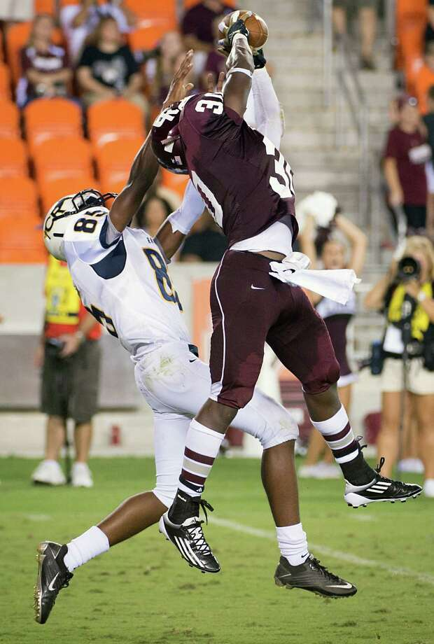 Cinco Ranch defensive back Jaylen Hunter (30) intercepts a pass intended for Cy Ranch receiver Malik Reedus (85) on the final play of a high school football game at BBVA Compass Stadium, Friday, Aug. 31, 2012, in Houston. Photo: Smiley N. Pool, Houston Chronicle / © 2012  Houston Chronicle