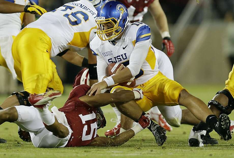 San Jose State quarterback David Fales is sacked by Stanford cornerback Usua Amanam (15) during the first half of an NCAA college football game in Stanford, Calif., Friday, Aug.  31, 2012. (AP Photo/Marcio Jose Sanchez) Photo: Marcio Jose Sanchez, Associated Press