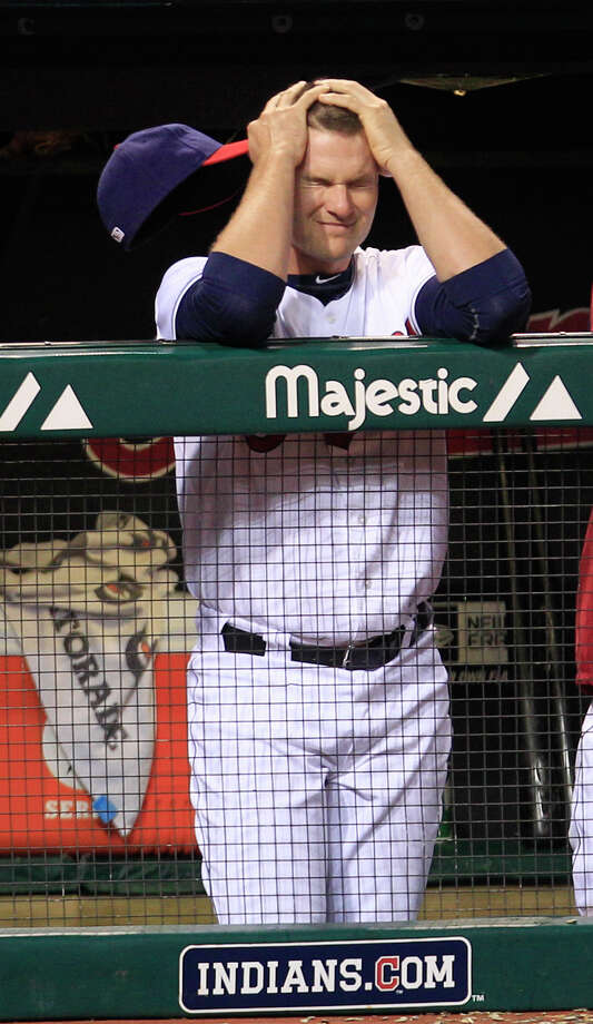 Cleveland Indians catcher Lou Marson reacts as he watches in the ninth inning of a baseball game against the Texas Rangers, Friday, Aug. 31, 2012, in Cleveland. The Rangers won 5-3. Photo: Tony Dejak