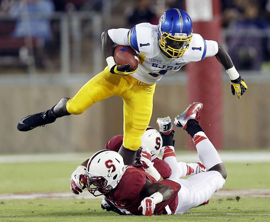 San Jose State wide receiver Jabari Carr leaps over Stanford defenders during the first half of an NCAA college football game in Stanford, Calif., Friday, Aug.  31, 2012. (AP Photo/Marcio Jose Sanchez) Photo: Marcio Jose Sanchez, Associated Press