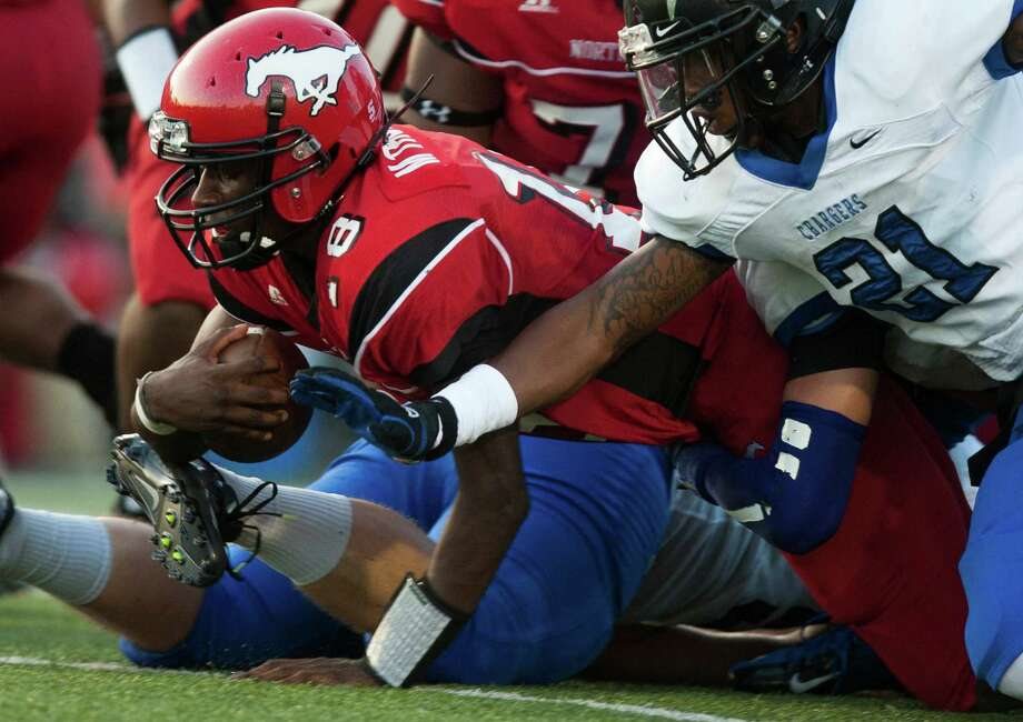 North Shore quarterback Micah Thomas (18) dives forward for extra yards during the first half against Clear Springs at the Galena Park Athletic Complex on Friday, Aug. 31, 2012, in Houston. Photo: J. Patric Schneider, Houston Chronicle / © 2012 Houston Chronicle