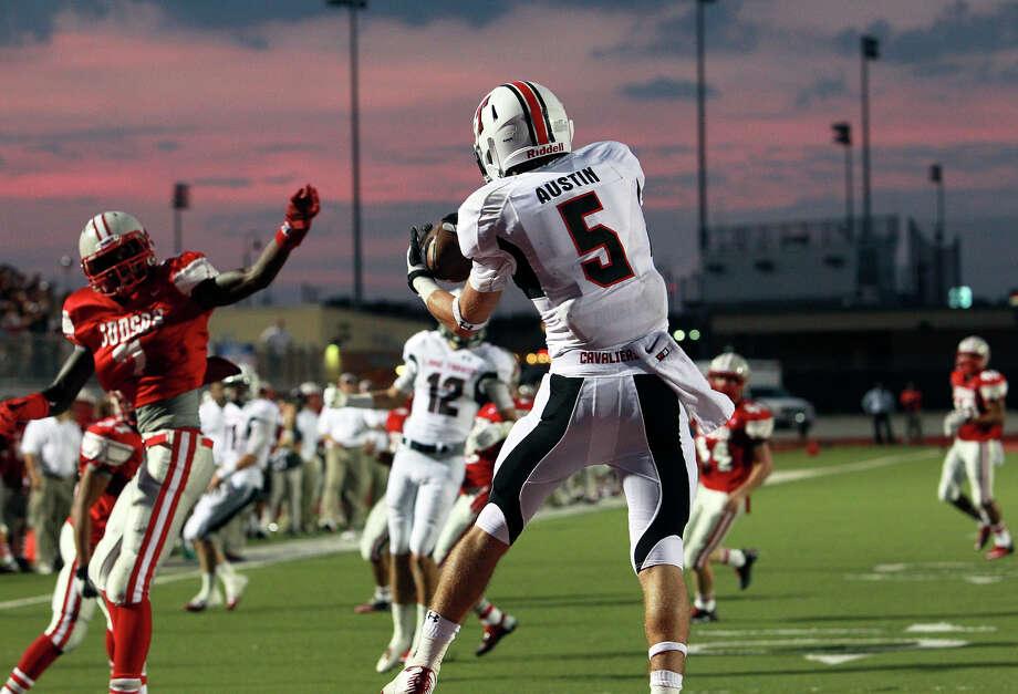 Zach Austinn pulls down a touchdown pass for Lake Travis as Judson hosts Lake Travis at D.W. Rutledge Stadiumt  on August 31, 2012. Photo: Tom Reel, Express-News / ©2012 San Antono Express-News
