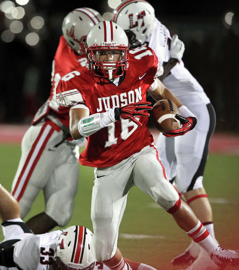 Rocket runner Cameron Johnson rolls on a long gainer in the second quarter as Judson hosts Lake Travis at D.W. Rutledge Stadiumt  on August 31, 2012. Photo: Tom Reel, Express-News / ©2012 San Antono Express-News