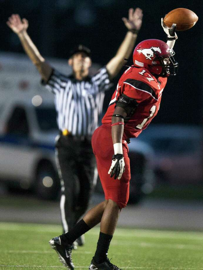 North Shore defensive back Jomal Wiltz (17) raises the ball in the air after an interception during the second quarter against Clear Springs at the Galena Park Athletic Complex on Friday, Aug. 31, 2012, in Houston. Photo: J. Patric Schneider, Houston Chronicle / © 2012 Houston Chronicle
