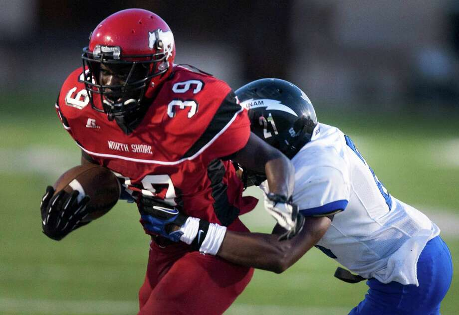 North Shore running back Herbert Hunter (39) is pushed out of bounds by Clear Springs Kamron Williams (21) during the second quarter at the Galena Park Athletic Complex on Friday, Aug. 31, 2012, in Houston. Photo: J. Patric Schneider, Houston Chronicle / © 2012 Houston Chronicle