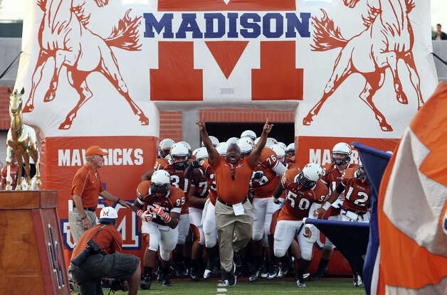 The Madison Mavericks make their way onto the field before their game against Steele at Heroes Stadium on Friday, August 31, 2012. Photo: Kin Man Hui, Express-News / ©2012 San Antonio Express-News