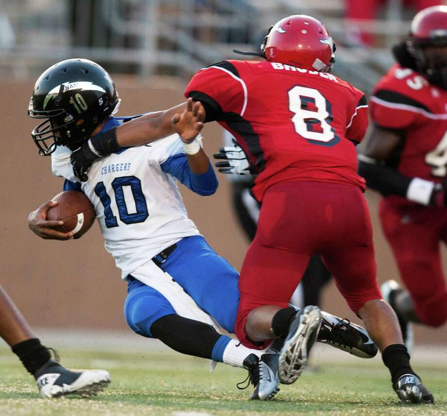 Clear Springs Matt Guidry (10) is taken down by North Shore defensive back Tim Broden (8) during the first half at the Galena Park Athletic Complex on Friday, Aug. 31, 2012, in Houston. Photo: J. Patric Schneider, Houston Chronicle / © 2012 Houston Chronicle