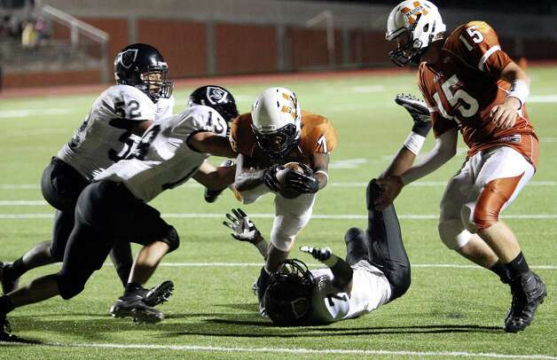 Madison's Marquis Warford (07) dives into the end zone for a touchdown against Steele's Roy Russell (19) in the second half at Heroes Stadium on Friday, August 31, 2012. Photo: Kin Man Hui, Express-News / ©2012 San Antonio Express-News
