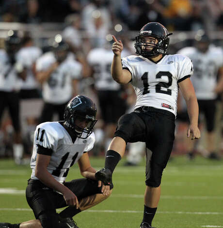 Steele kicker Evan Kotzur (12) gestures after a successful field goal attempt against Madison in the first half at Heroes Stadium on Friday, August 31, 2012. Photo: Kin Man Hui, Express-News / ©2012 San Antonio Express-News