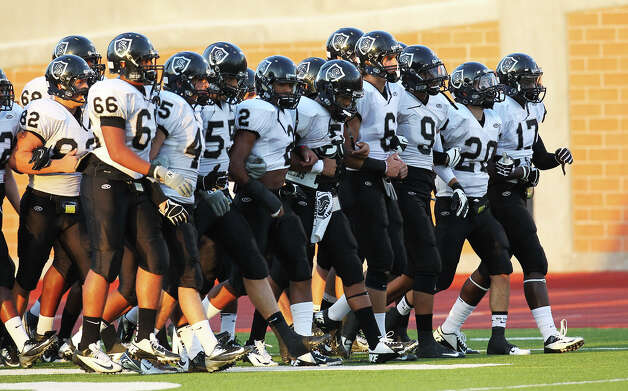 The Steele Knights stroll onto the field for their game against Madison at Heroes Stadium on Friday, August 31, 2012. Photo: Kin Man Hui, Express-News / ©2012 San Antonio Express-News
