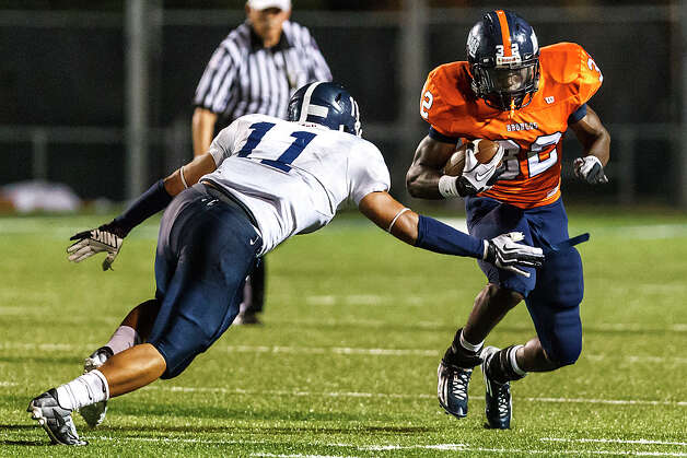 Brandeis running back Peter Agu-Udemba (right) tries to elude Smithson Valley's Sebastian Sanchez during the season opener for both teams at Farris Stadium on Aug. 31, 2012. Smithson Valley won the game 41-7.  MARVIN PFEIFFER/ mpfeiffer@express-news.net Photo: MARVIN PFEIFFER, Express-News / Express-News 2012