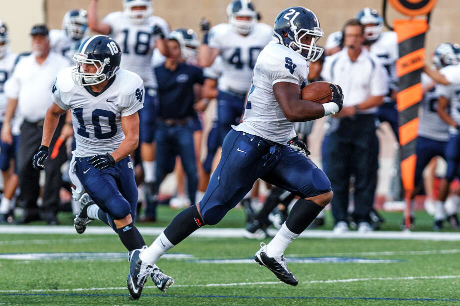 Smithson Valley's Taylor West (left) looks for someone to block as Lawrence Mattison takes off on a 75-yard touchdown run on the Rangers first offensive play in their game with Brandeis at Farris Stadium on Aug. 31, 2012.  Mattison ran for 137-yards in the Ranger's 41-7 victory in the season opener for both schools.  MARVIN PFEIFFER/ mpfeiffer@express-news.net Photo: MARVIN PFEIFFER, Express-News / Express-News 2012