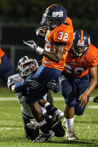 Smithson Valley linebacker George Schwanenberg brings down Brandeis running back Peter Agu-Udemba during the season opener for both teams at Farris Stadium on Aug. 31, 2012.  Smithson Valley won the game 41-7.  MARVIN PFEIFFER/ mpfeiffer@express-news.net Photo: MARVIN PFEIFFER, Express-News / Express-News 2012