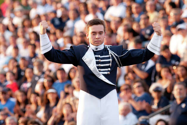 Central Catholic drum major J.J.Herron leads the band prior to the game versus Holy Cross. Photo: Express-News
