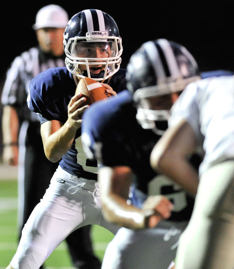 Central Catholic quarterback  Joseph Nava looks for a receiver during first half action versus Holy Cross. Photo: Express-News