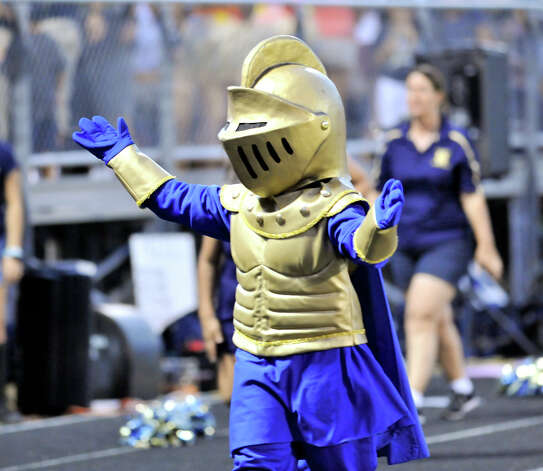 The Holy Cross Knight encourages the fans during their game versus Central Catholic. Photo: Express-News