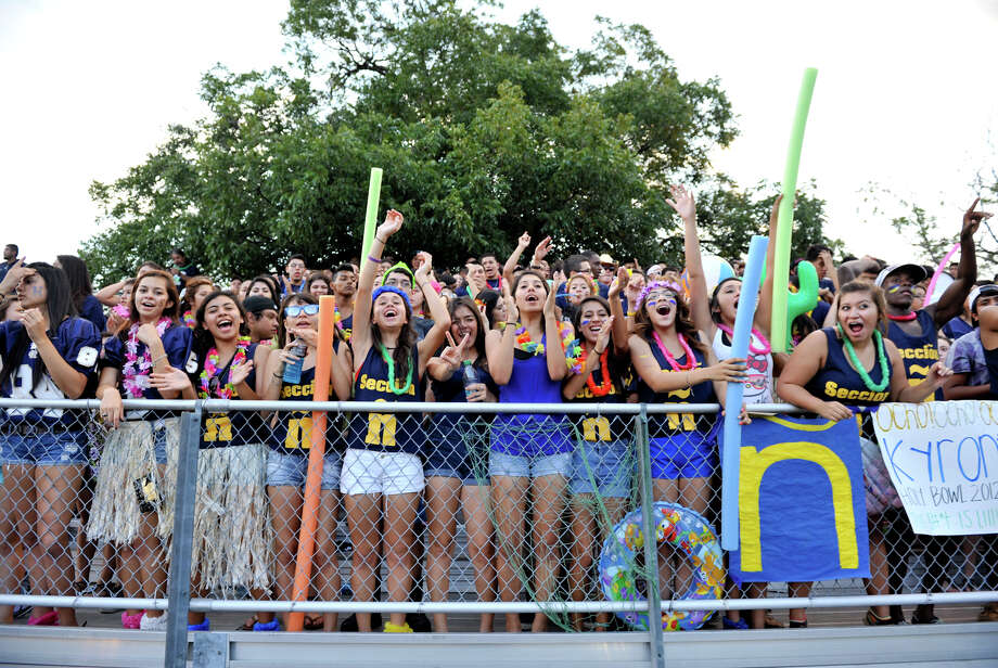Holy Cross fans cheer their team versus Central Catholic. Photo: Express-News