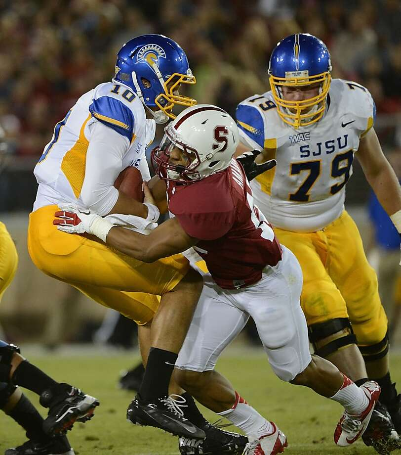 David Fales #10 of San Jose State University gets sacked by Usua Amanam #15 of Stanford University in the second quarter during an NCAA football game at Stanford Stadium on August 31, 2012 in Palo Alto, California. (Photo by Thearon W. Henderson/Getty Images) Photo: Thearon W. Henderson, Getty Images