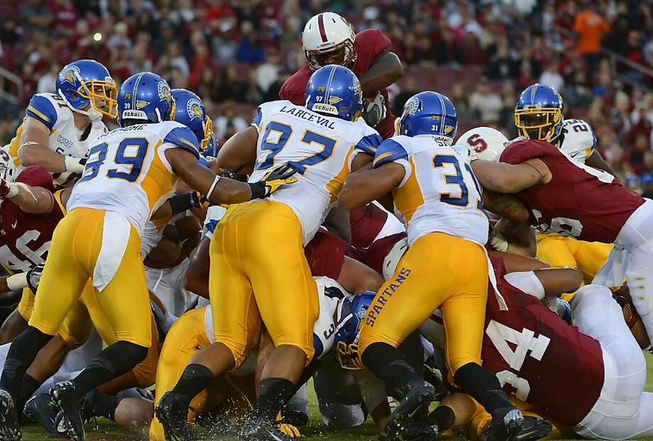 Stepfan Taylor #33 of Stanford University dives over the San Jose State University defense for a one yard touchdown in the first quarter of an NCAA football game at Stanford Stadium on August 31, 2012 in Palo Alto, California. (Photo by Thearon W. Henderson/Getty Images) Photo: Thearon W. Henderson, Getty Images