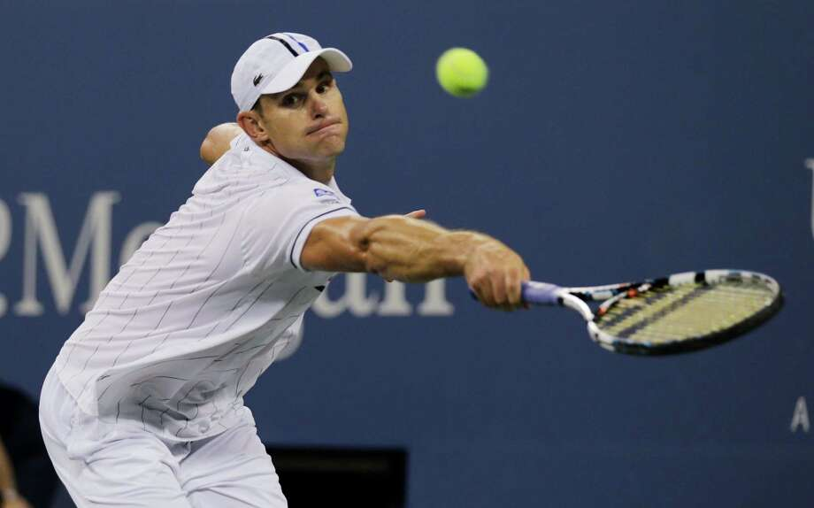 Andy Roddick returns a shot to Australia's Bernard Tomic in the third round of play at the 2012 US Open tennis tournament,  Friday, Aug. 31, 2012, in New York. (AP Photo/Charles Krupa) Photo: Charles Krupa