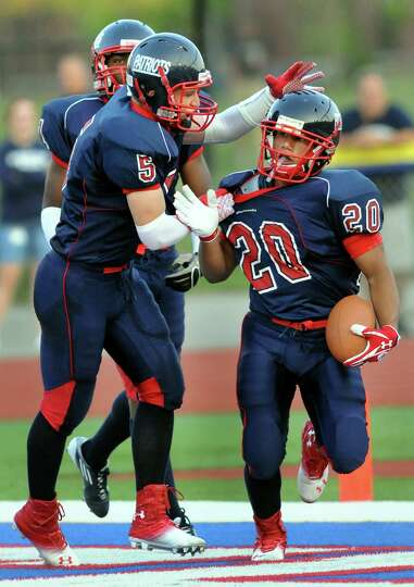 Schenectady's running back Felix Rodriguez (20), right, celebrates the first touchdown of the game w