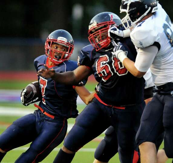 Schenectady's running back Hassan Rainey (7), left, receives protection from teammate Rasheen Brunso
