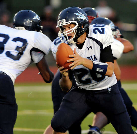 Columbia's quarterback Austin Lobban (20) hands off the ball during their football game against Sche