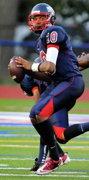 Schenectady's quarterback Kwame Jarvis (10) looks to pass during their football game against Columbi