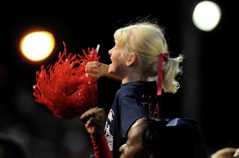 Cheer camp member Shea Bisner-Boulay, 9, shows team spirit with Schenectady's cheerleaders during th