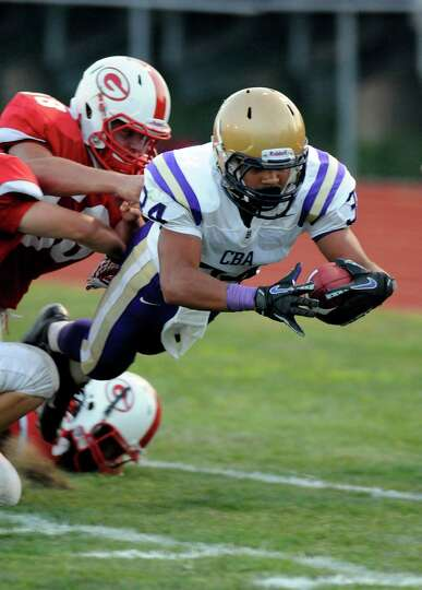Christian Brothers Academy's runningback Cameron Wynn(34) is forced out of bounds at the goal by Gui