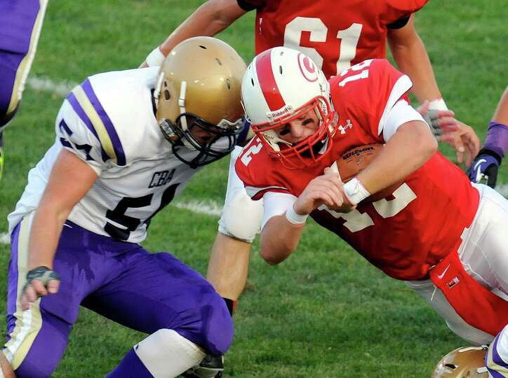 Christian Brothers Academy's Griffin Clark(54) stops Guilderland quarterback Joe Bender (12) during