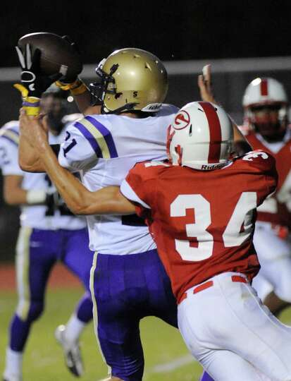 Christian Brothers Academy's Connor Crotty ,left, catches a pass for a touchdown while being defende