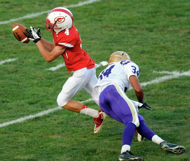 Guilderland's Jacob Smith (4) can't hold onto a pass while being defended by Christian Brothers Acad
