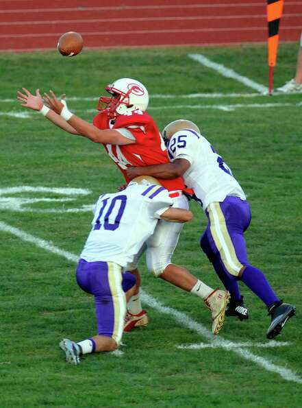 Guilderland's Connor Gallup (44) can't pull in a pass while being defended by Christian Brothers Aca
