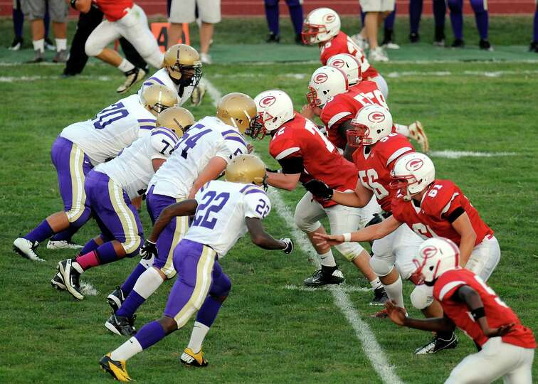 Christian Brothers Academy's defensive line and Guilderland's offensive lines match up during their