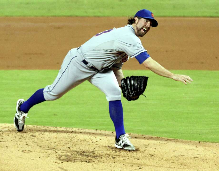 MIAMI, FL - AUGUST 31:  Pitcher R.A. Dickey #43 of the New York Mets throws  against the Miami Marlins at Marlins Park on August 31, 2012 in Miami, Florida.  (Photo by Marc Serota/Getty Images) Photo: Marc Serota